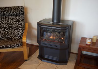 Fisheye9 - Great Ocean Road accommodation. Relax by the warm, cosy gas log fire.