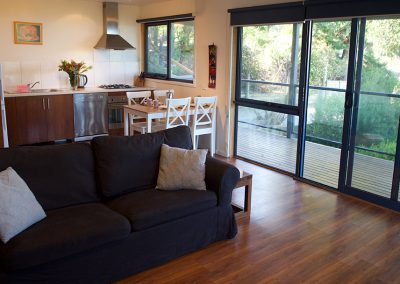 Fisheye9 - Great Ocean Road accommodation. Cosy living area with bush and ocean views.